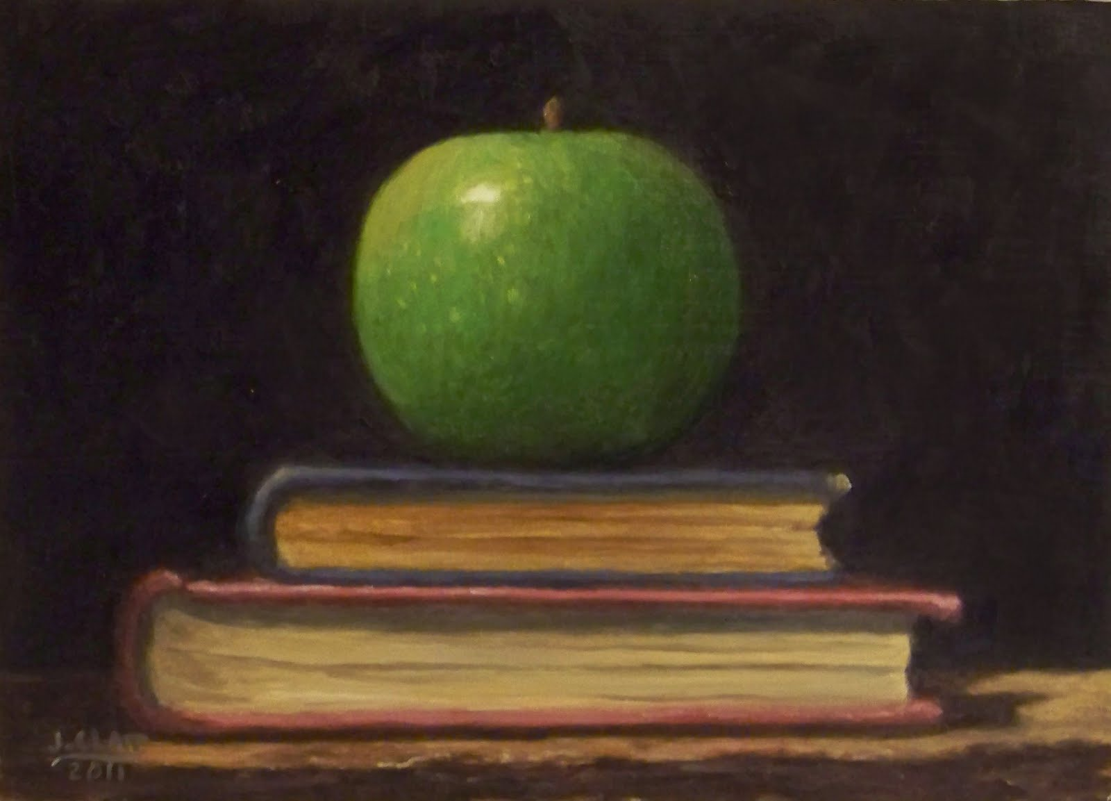 Green Apple on antique books